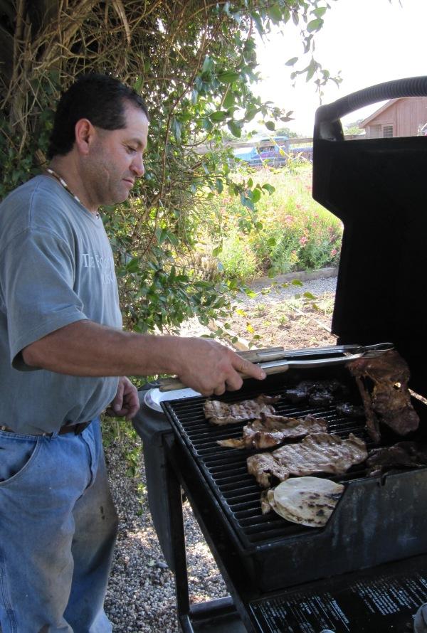 Oscar mans the grill